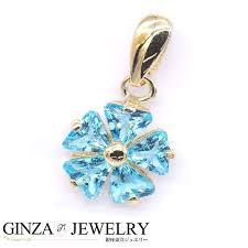 k14yg yellow gold pendant top light blue stone flower design to and fro
