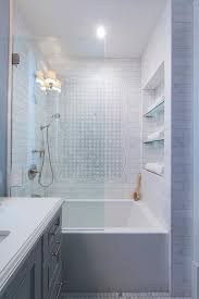 drop in bathtub with glass partition and glass shelves