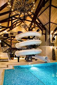 mansion with indoor pool with slides.  Pool Amazing 3Story Indoor Swimming Pool With Water Slide Rock Climbing Wall  Alberta Canada Mansion Slides Pinterest