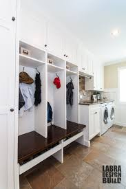 Laundry + Mudroom Combo with Custom Cabinetry and Wainscoting by ...