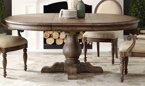 lovely 60 inch expandable round pedestal dining table with vintage french style dining chairs with