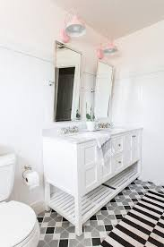 white and pink girls bathroom with black and white stripe rug