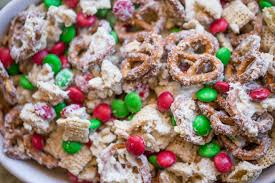 white chocolate trash snack mix with pretzels cereal peanuts and chocolate coated cans
