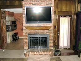 how to mount a tv on a brick fireplace mounting above fireplace hiding wires how to