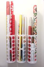Create this simple DIY wrapping paper storage idea using Ikea's Variera  plastic bag dispensers. Get