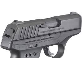 sights are machined integrally with the slide and feature glare reducing rear facing serrations