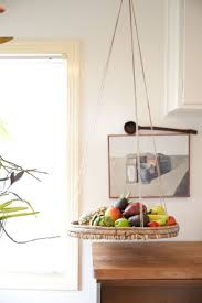 Hanging Baskets Will Save Your Little Kitchen From Big Clutter