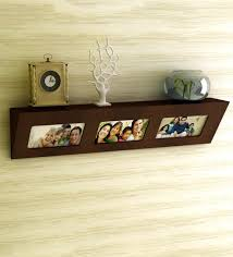 floating wall shelf with 3 photo frames in brown finish by home sparkle contemporary wall shelves contemporary wall shelves wall art