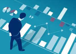 The manager analyzes business chart - Canadian Underwriter Canadian  Underwriter