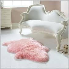pink sheepskin rug rugs home decorating ideas