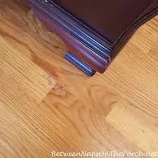 latex rubber stuck to hardwood flooring from deteriorating rug backing