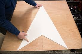 trace the star template on the sheet wood five times for all five points of