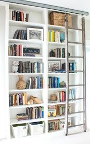 bookcase with ladder rolling