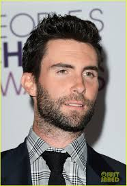 About this photo set: Adam Levine shows off his award at the 2013 People's Choice Awards held at Nokia Theatre L.A. Live on Wednesday (January 9) in Los ... - adam-levine-peoples-choice-2013-12