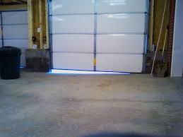 garage door way off due to uneven slope