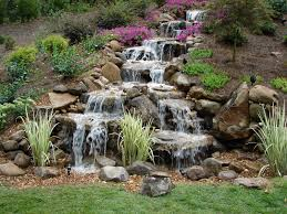 Lawn & Garden:Interesting Stone Backyard Design With Multilevel Waterfall  And Nice Looking Purple Flower