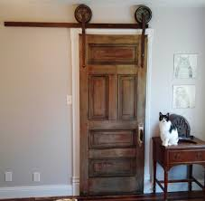 rolling sliding closet door made from parts and pieces around the you