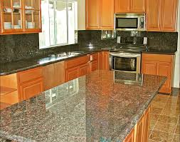 beech coffee cabinets with sapphire brown granite countertops