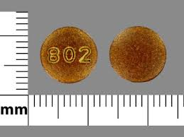 its a brown round pill with 802 on it