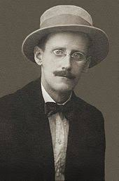a portrait of the artist as a young man  a black and white photographic portrait of a mustachioed man glasses in a