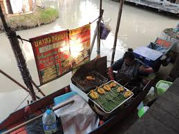 street food in thailand photo essay rathina s view space grilled squids in a boat