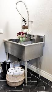 stainless steel utility sink freestanding. Laundry Room Features Freestanding Stainless Steel Dual Utility Sink Paired With Pullout Faucet Atop Black Slate Herringbone Tile Floor To