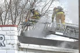 twin city glass firefighters work to contain a fire at the twin city glasirror
