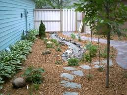 drain tile yard drain tile and a french drain combined add a natural look for the