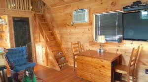 Small Picture It Seems Like A Cute Wooden Tiny House But Up The Stairs WHOA