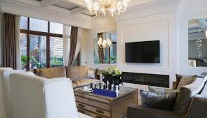 mirror in living room feng shui. two mirrors flanking the television and fireplace reflect light outdoors. mirror in living room feng shui r