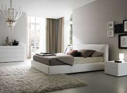bedroom white leather bed with brown bed sheet plus cream fur rug plus white wooden