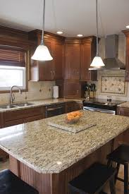 Maple Nutmeg Cabinets With Granite Tops And Light Colored Floor And