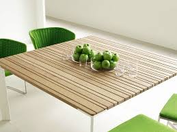 square wooden garden table sunset square table by paola lenti