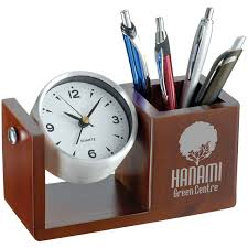 fancy inc aluminium desk clock with pen holder in a wooden finish