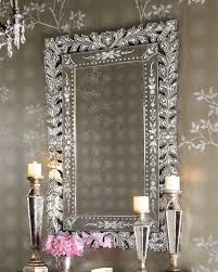 Rectangle Mirror With Silver Steel Carving Frame Placed On The Gray