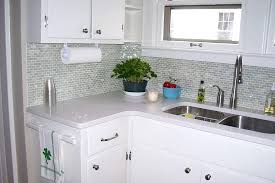 kitchen backsplash glass tiles and adding new counters a glass tile and painting the cabinets created