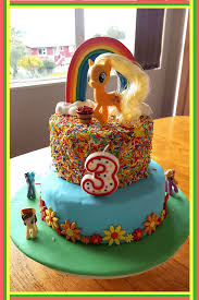 i am no cake decorator so last year i kept it simple and made this my little pony cake the flowers were made using a fondant flower cutter the ponies all