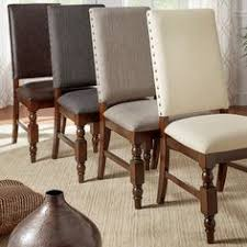 featuring nailhead trim and a modern silhouette these dining room chairs coordinate seamlessly with mo