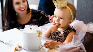 One year old boy is celebrating his first birthday and eating festive cake. 22 Memorable First Birthday Gift Ideas