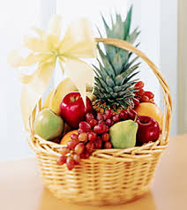the gift of fruit is a great way to tell someone you are thinking of them or to celebrate a special event a handled basket is filled with the day s