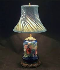 moorcroft orchid pattern pottery lamp base cobalt blue ground c 20th century england