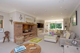 red brick fireplace living room traditional with log basket word and symbol