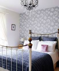 Adding chic wallpaper behind your headboard might be just what your bedroom  needs