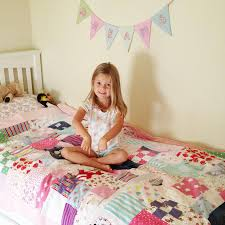 Patchwork Castle - Beautiful Memory Quilts & Keepsake Cushions ... & A happy customer with her Signature Mosaic Baby Clothes Quilt - single size. Adamdwight.com