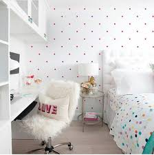 Pink polka dot room with multicolored polka dot sheets