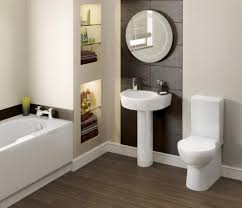 design ideas for bathrooms. Lowes Bathroom Ideas Using Round Mirror And Pedestal Sink Also Wooden Floor For Decoration Design Bathrooms