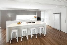 This sleek modern kitchen design incorporates white, silver and ...