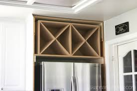 cabinets the makings of decorative wine rack black and white kitchen makeover reveal hometalk wine rack cabinet above fridge e31 above