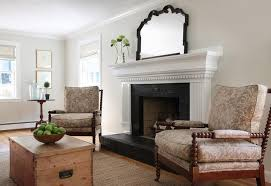 white fireplace mantle with black brick surround and hearth