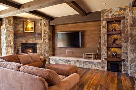 country family room with cypress ridge stone veneer exposed beam hardwood floors stone
